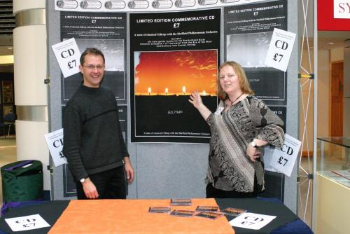 Geoff and Cath Olner get ready to sell CD's