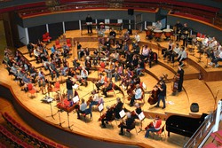 The orchestra rehearse