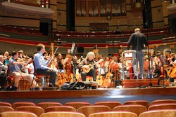 Gordon Andrew and the orchestra rehearse